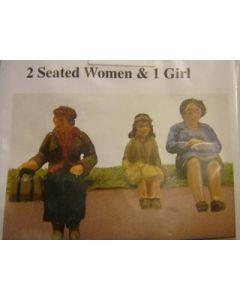 2 sitzende Frauen & 1 Mädchen