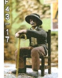Mann auf Stuhl sitzend